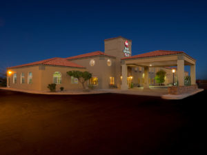 Hotel exterior at night at the Best Western PLUS Winslow Inn - Winslow, Arizona